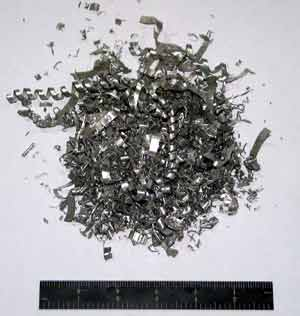 Aluminum chips and pucks formed from aluminum chips.