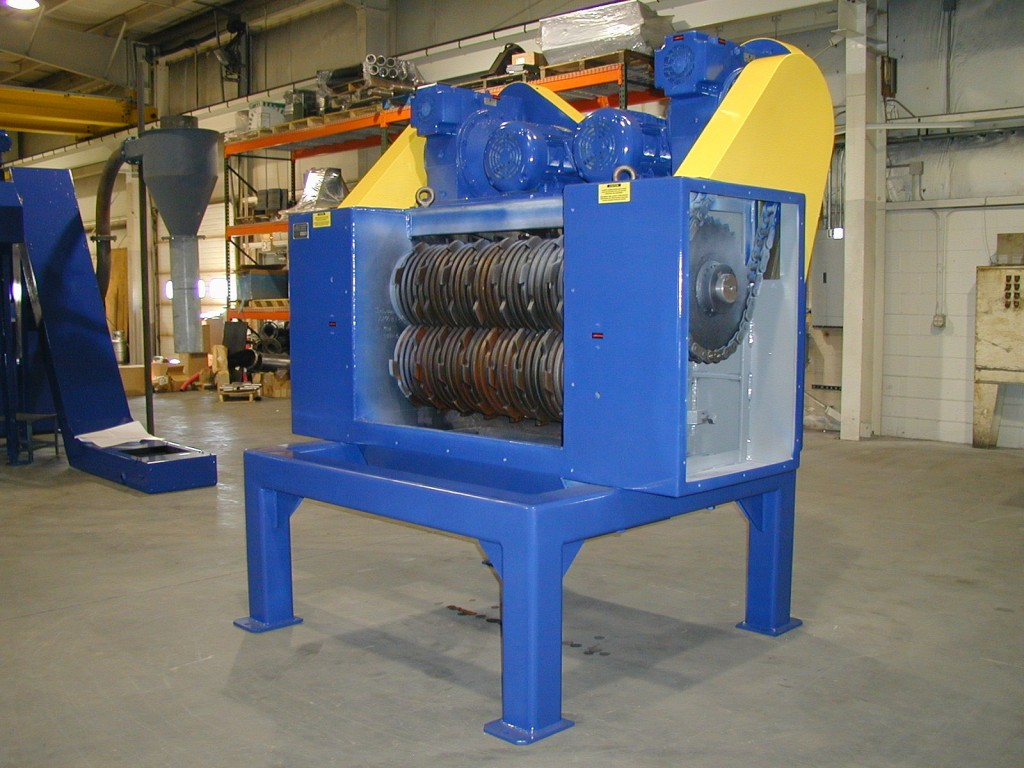 Large shredder shown; shredders available with mechanical or hydraulic, single or dual drives. Click for more examples.