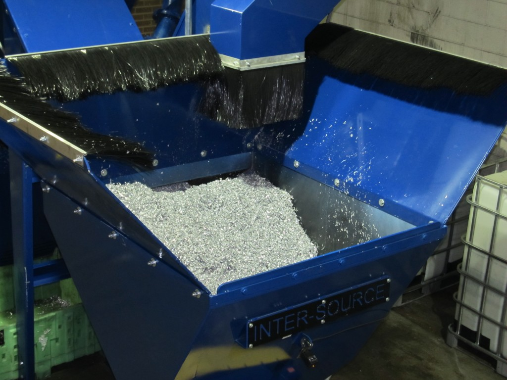 Feed conveyor processing chips.